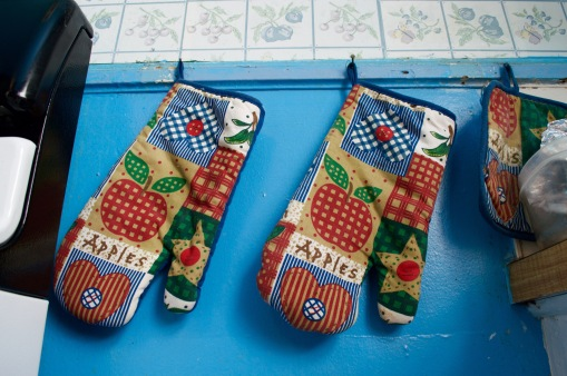 Oven mittens covered in the smell of Thanksgiving.